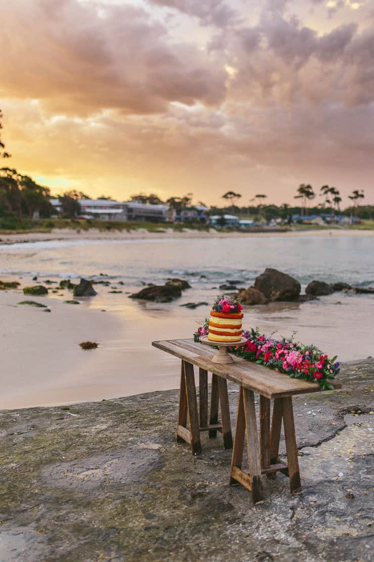 Beach wedding cake at sunset