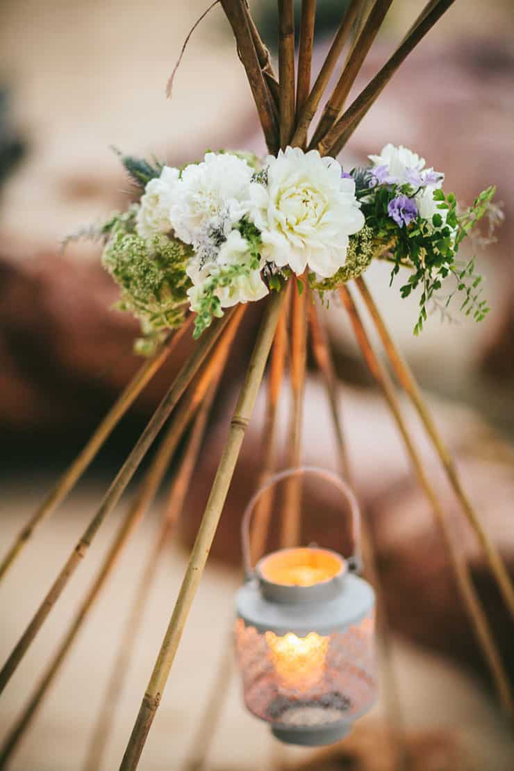 Beach wedding teepee flowers and lantern