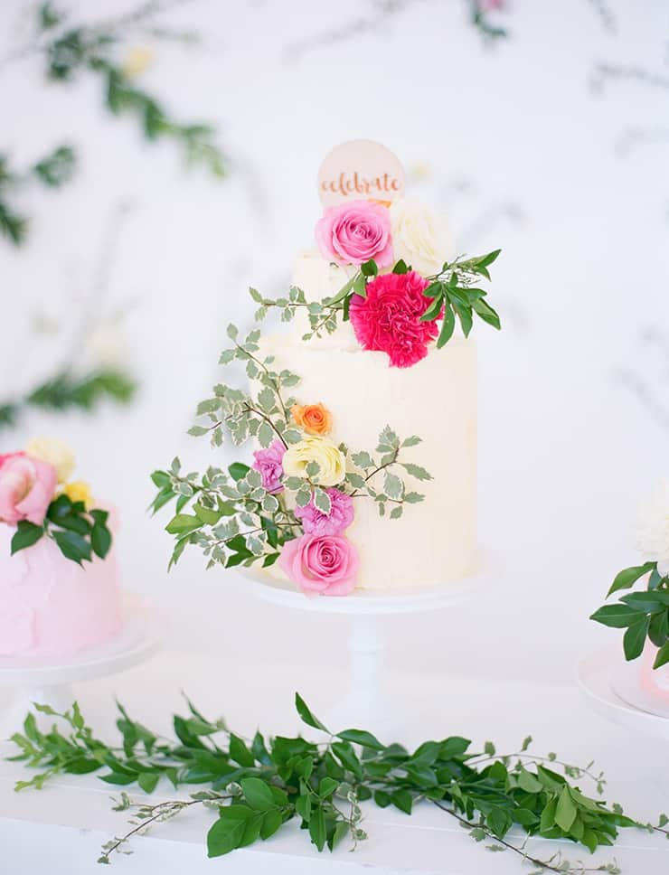 Garden party wedding cake with fresh flowers and greenery