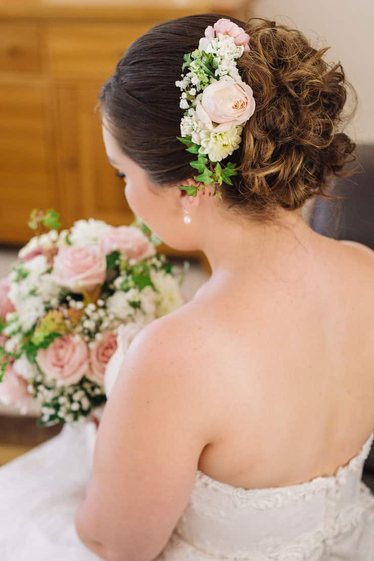 Bride wearing floral hair comb