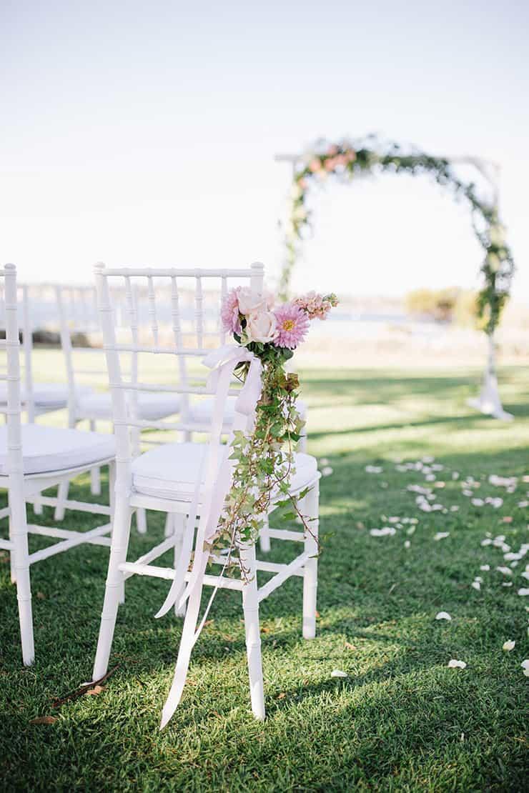 Ceremony aisle floral chair decor