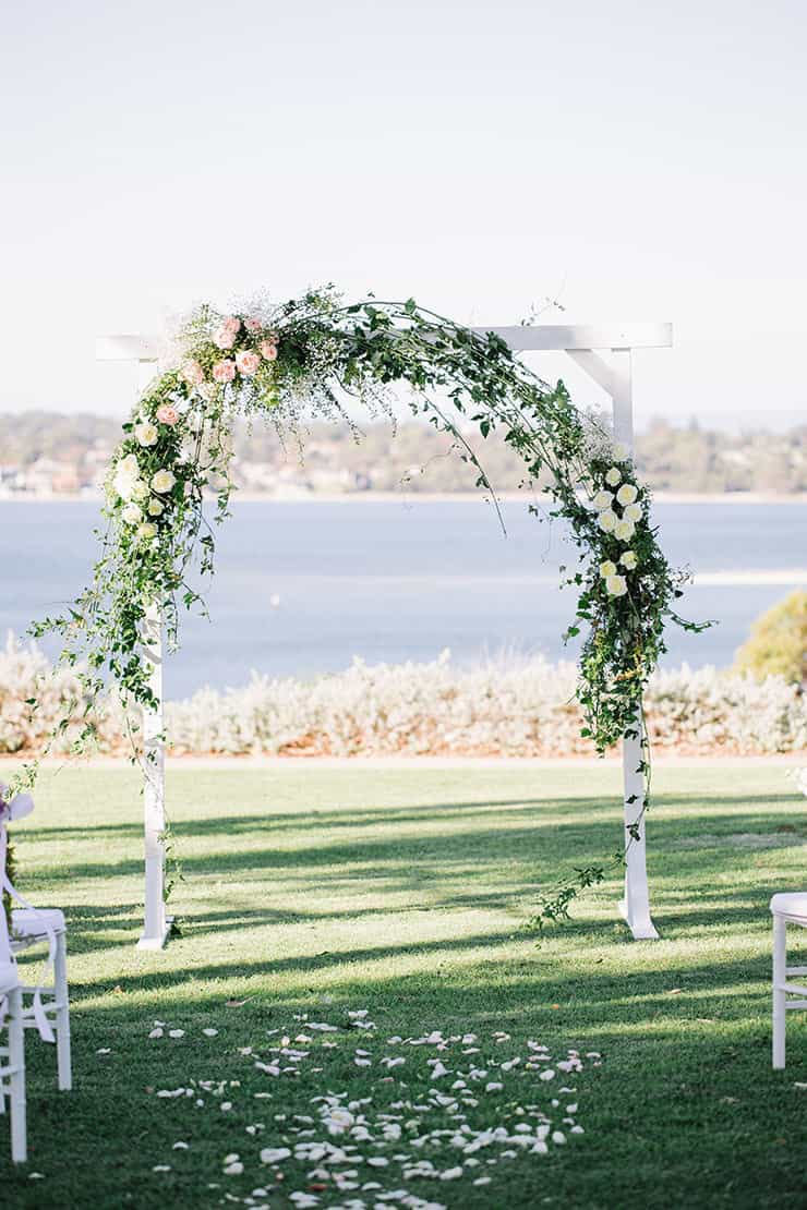 Romantic ceremony arbour with roses and greenery