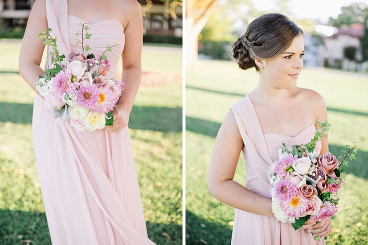 Bridesmaid wearing pink dress and carrying bouquet