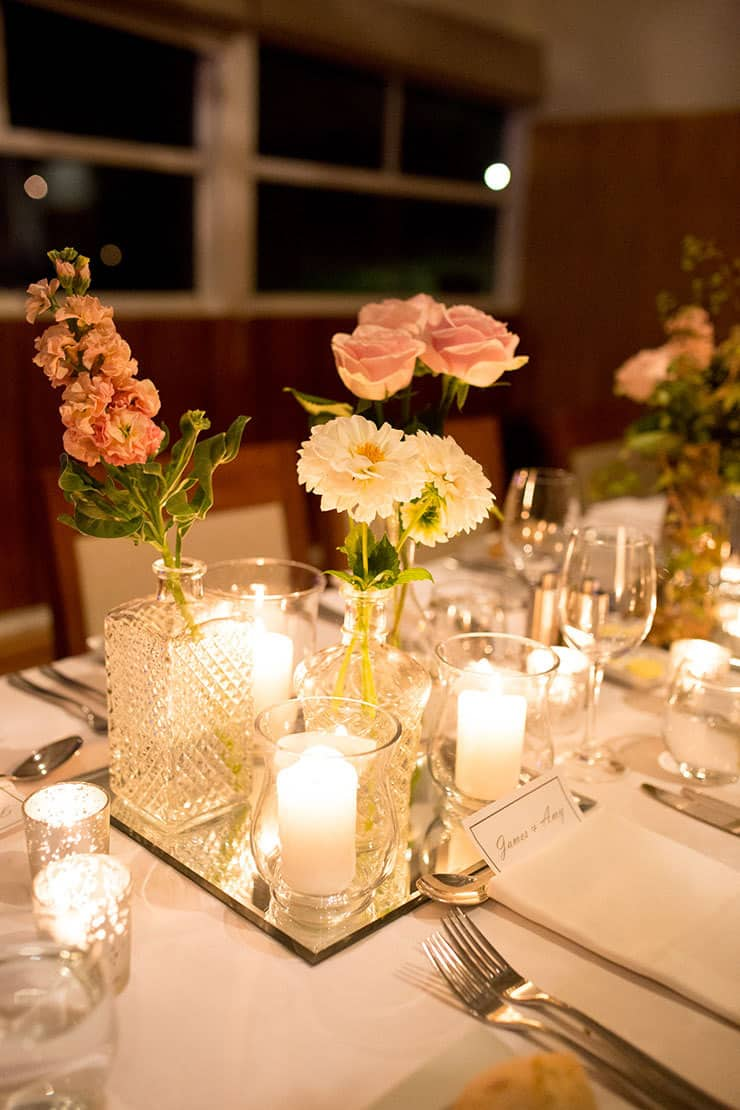 Reception centrepiece of bud vases and candles