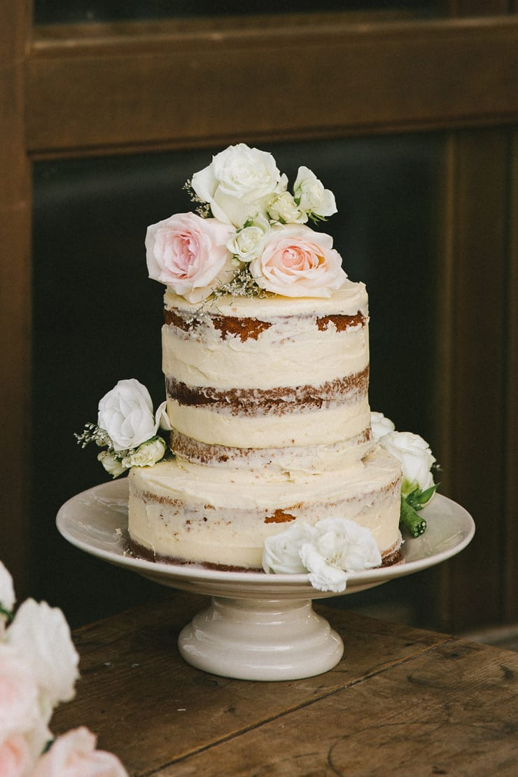 Rustic semi-naked wedding cake with roses