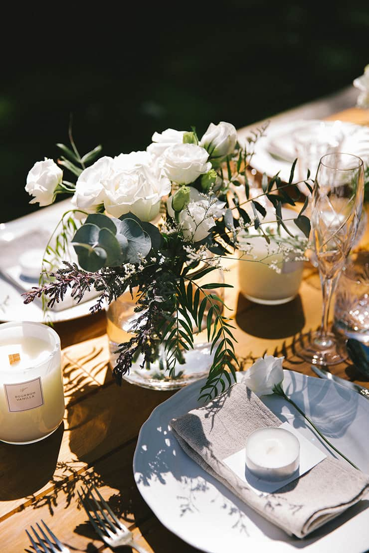 Rustic green and white outdoor wedding reception centrepiece