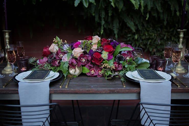 Jewel toned wedding reception centrepiece   Lola Images