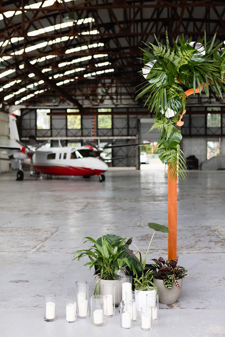 Matte Black and Greenery Wedding Inspiration in an Aircraft Hangar | Lyndal Carmichael Photography