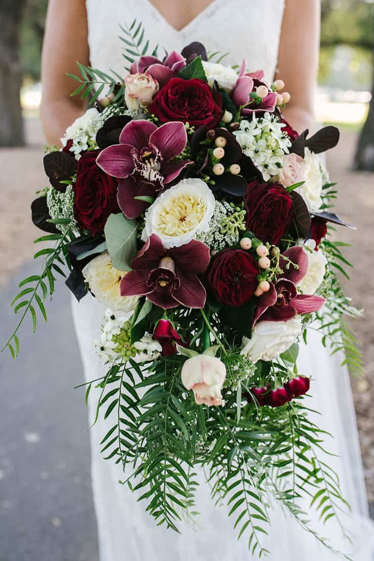 A Modern Black Tie Wedding With Burgundy Bouquets
