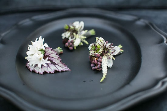 Botanical purple and white wedding buttonholes on black plateware | Samuel Lippke via Green Wedding Shoes