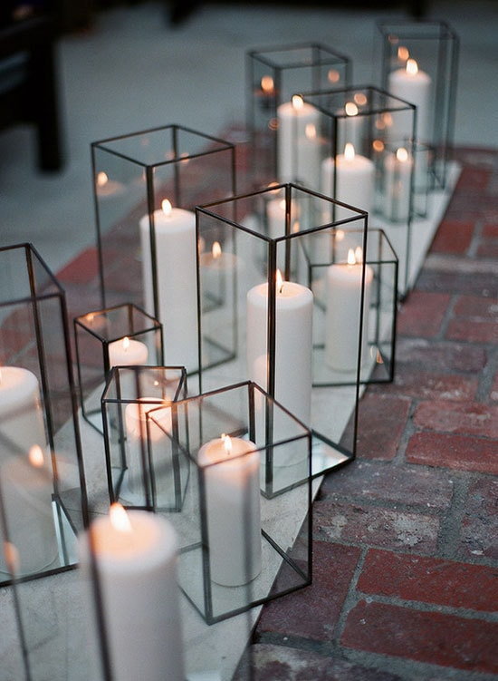 Modern black wedding lanterns with white pillar candles | Greg Finck via 100 Layer Cake