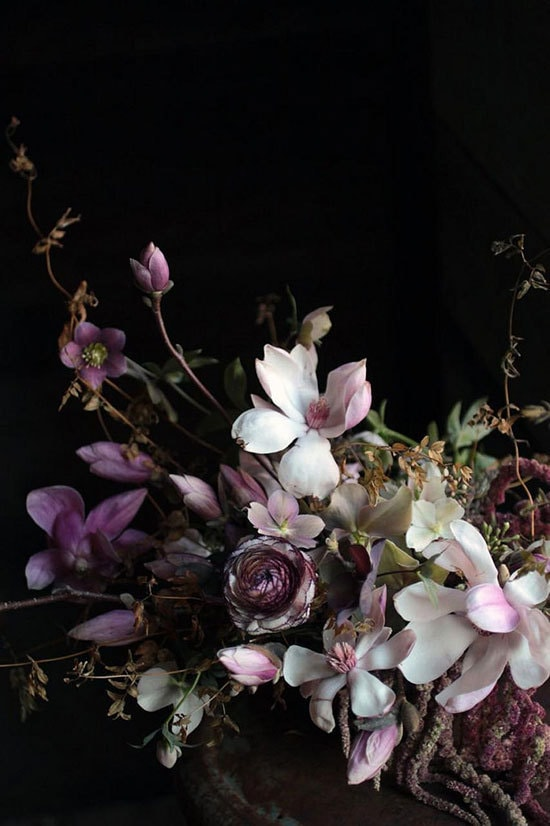 Moody botanical wedding centrepiece featuring purple and white flowers on a black backdrop | Sarah Ryhanen