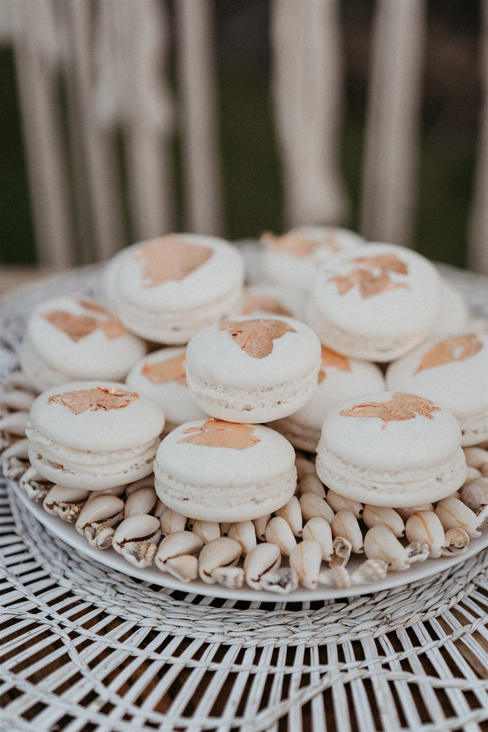 Outdoor Festival Bohemian Wedding Inspiration   A stack of white macarons topped with gold leaf for a bohemian wedding dessert table.   Photography: Shae Estella Photo