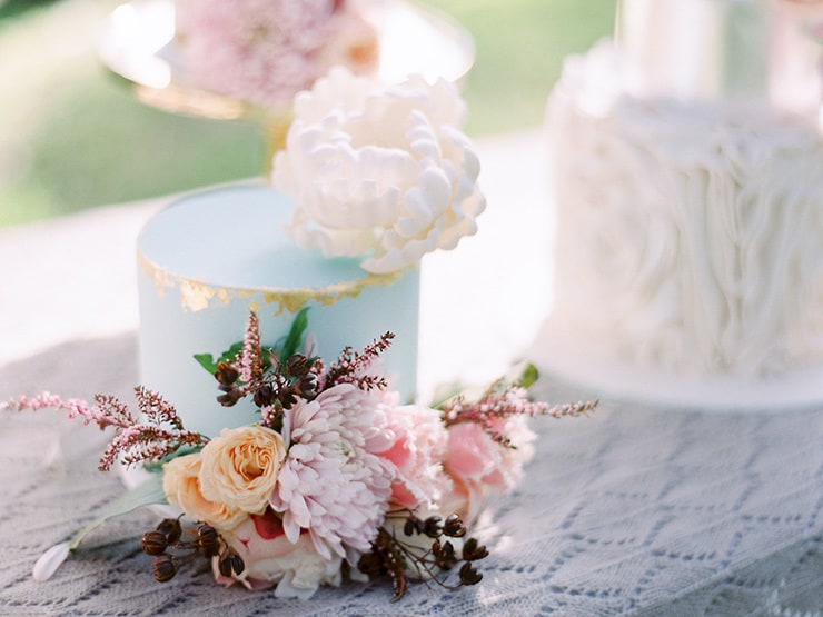 Soft blue wedding cake with gold foil and sugar peony