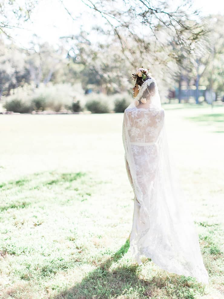 Boho bride wearing lace robe and veil