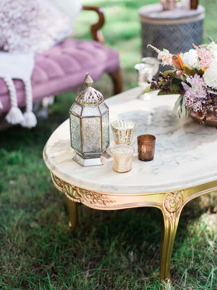 Boho wedding decor on gold and marble coffee table
