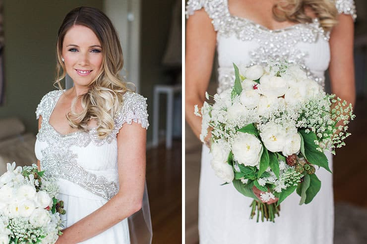 Bride wearing Anna Campbell wedding dress with bouquet