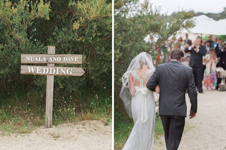 Handmade wedding sign and father walking bride down the aisle