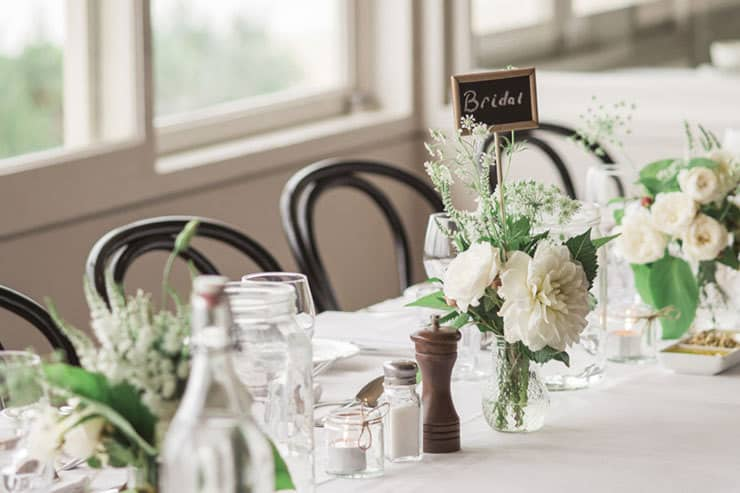Green and white wedding reception centrepieces