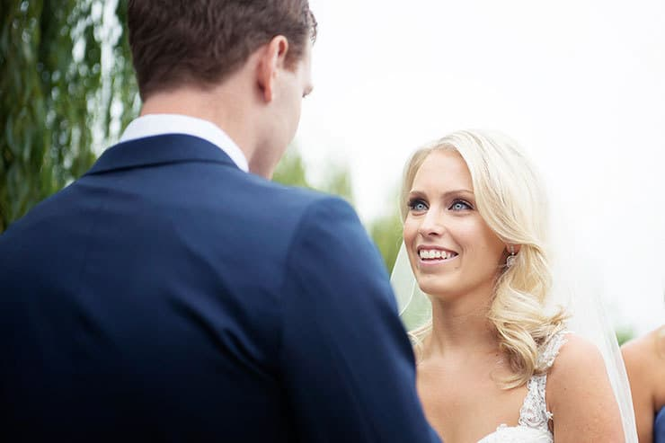 Bride and groom exchanging wedding ceremony vows