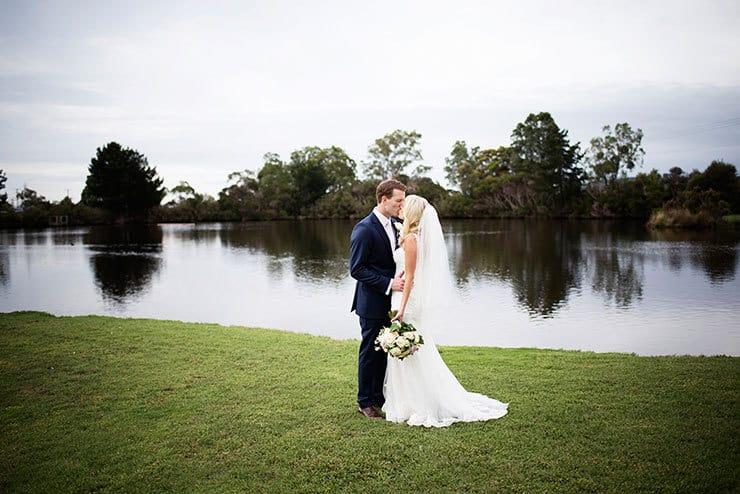 Pretty winery wedding bride and groom