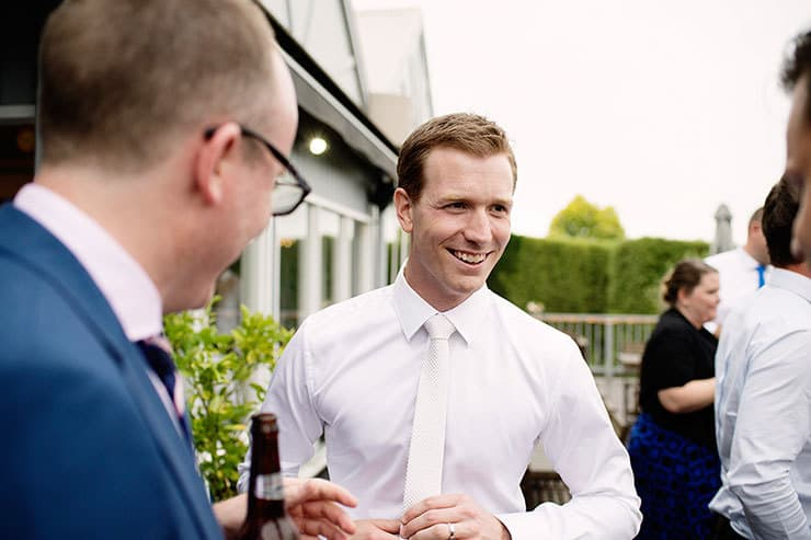 Groom at cocktail hour with guests