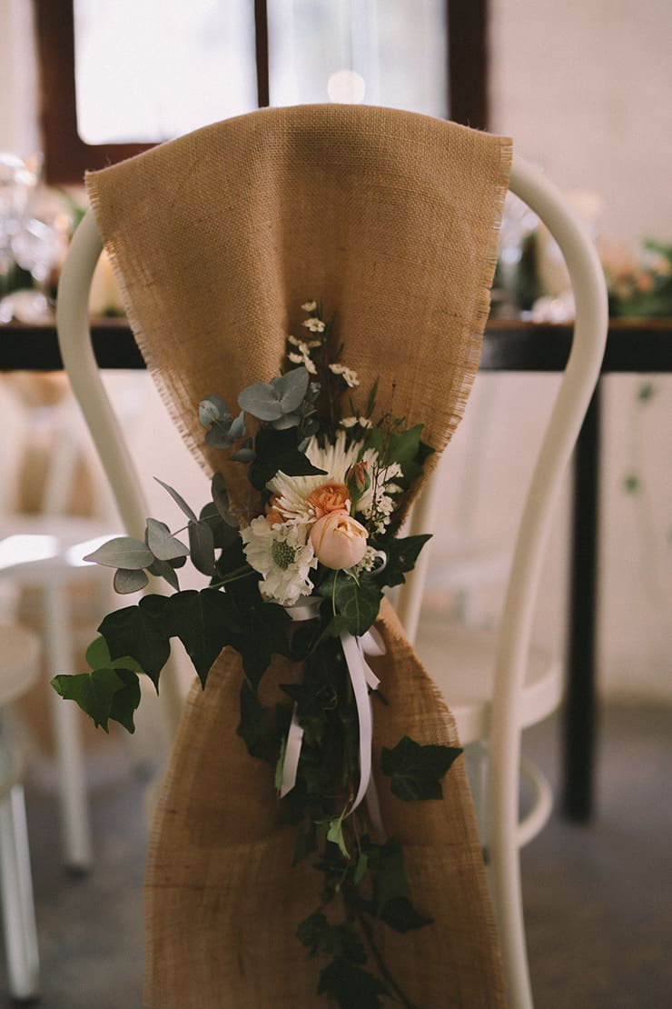 Relaxed-Vintage-Boho-Wedding-Inspiration-Reception-Chair-Back-Flowers-3