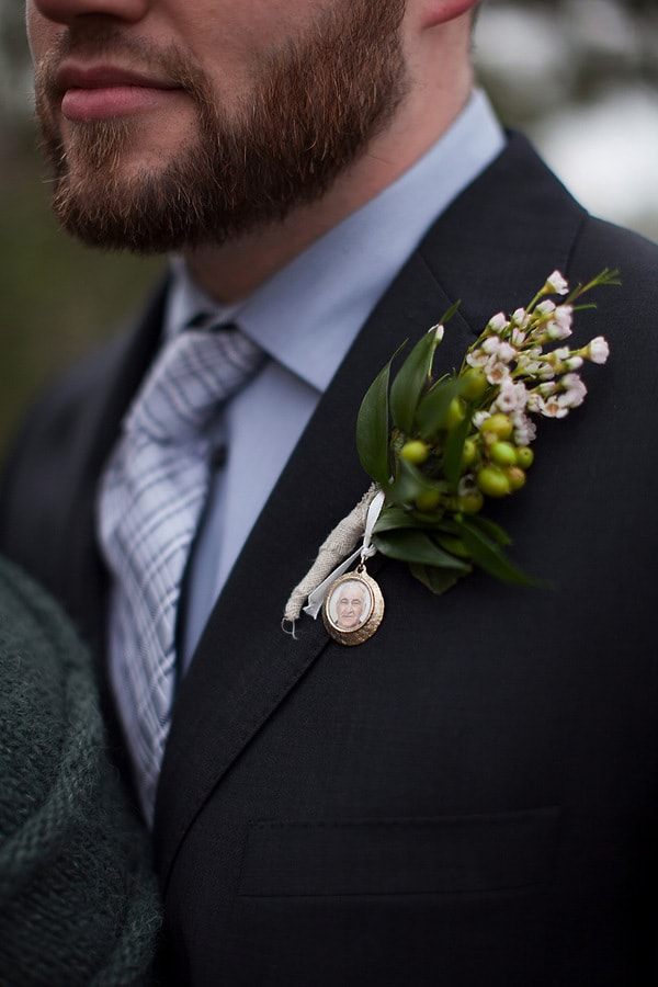 Remember lost loved ones at your wedding with a photo locket pinned to your boutonniere | Caroline Ross Photography
