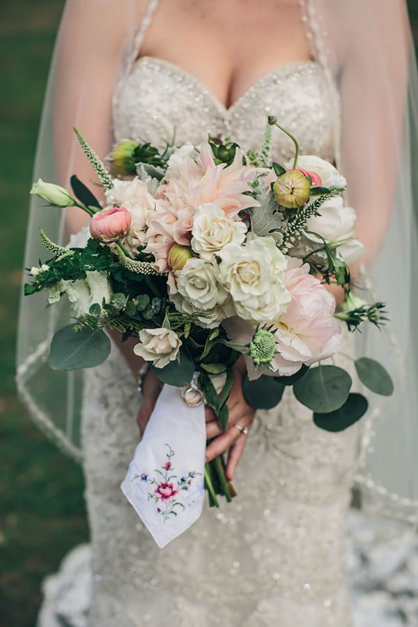 Remember lost loved ones at your wedding with a personal item attached to your bouquet   Richard Bell Photography via Every Last Detail