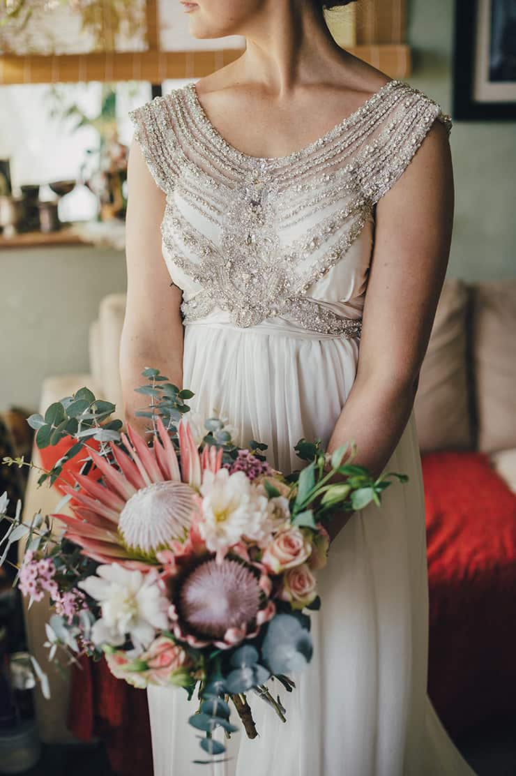 Romantic Anna Campbell beaded wedding dress and Protea bouquet