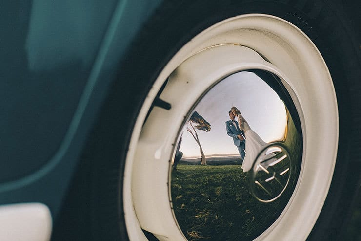 Reflection of bride and groom in Kombi wheel