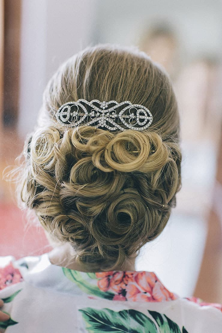 Elegant bride updo with curls and crystal comb