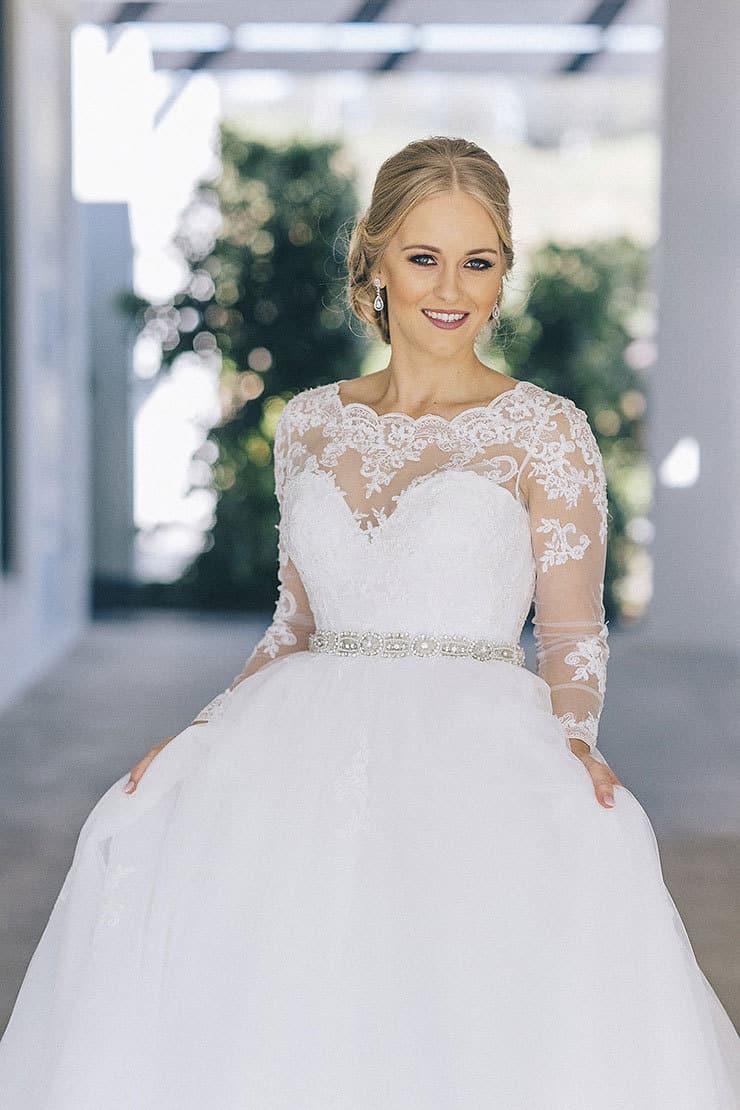 Elegant long sleeved lace wedding dress