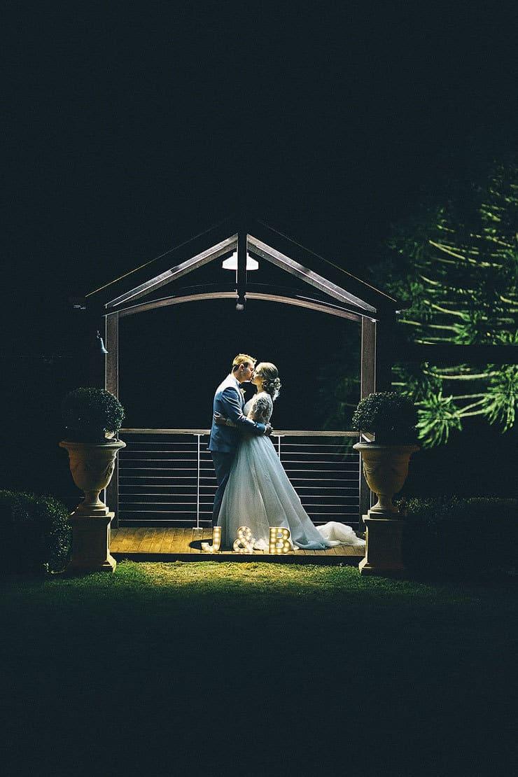 Bride and groom outdoor night portrait