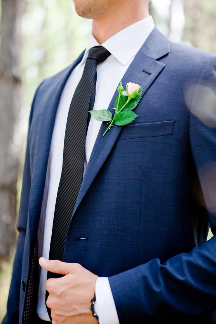 Navy suit with pink rose boutonniere