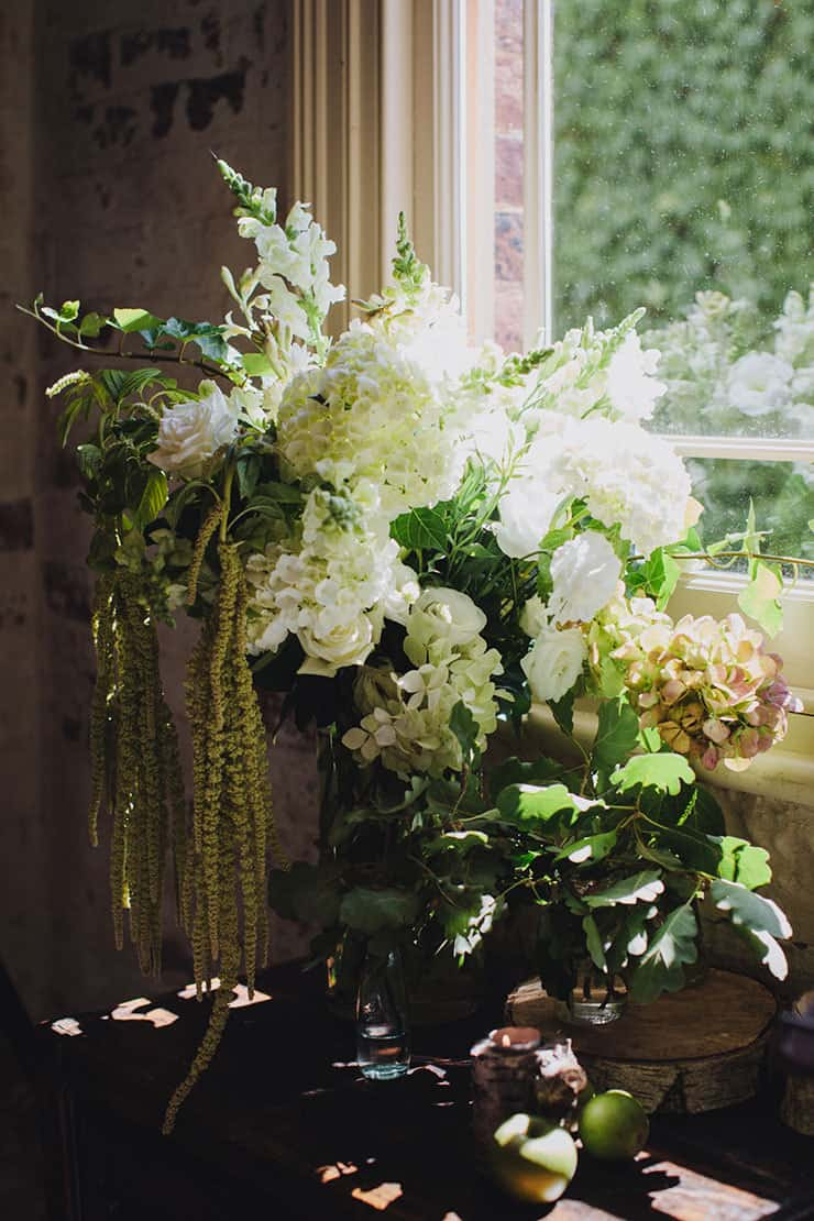 Romantic-Woodland-Wedding-Reception-Venue-Styling-Green-White-Floral-Arrangement
