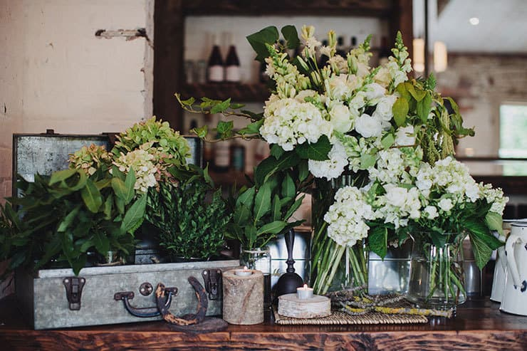 Romantic-Woodland-Wedding-Reception-Venue-Styling-Green-White-Flower-Decor