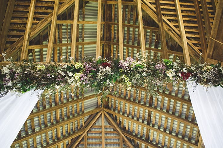 Rustic-Burgundy-Country-Wedding-Ceremony-Arbour-Flowers