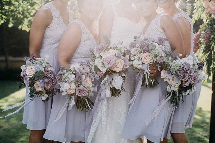 Lavender lace bridesmaid dresses with soft purple bouquets