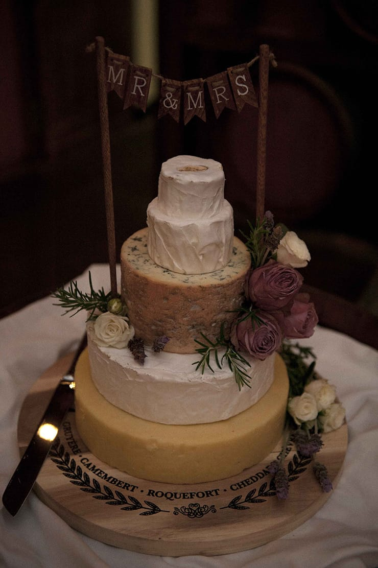 Rustic cheese wheel cake for winery wedding