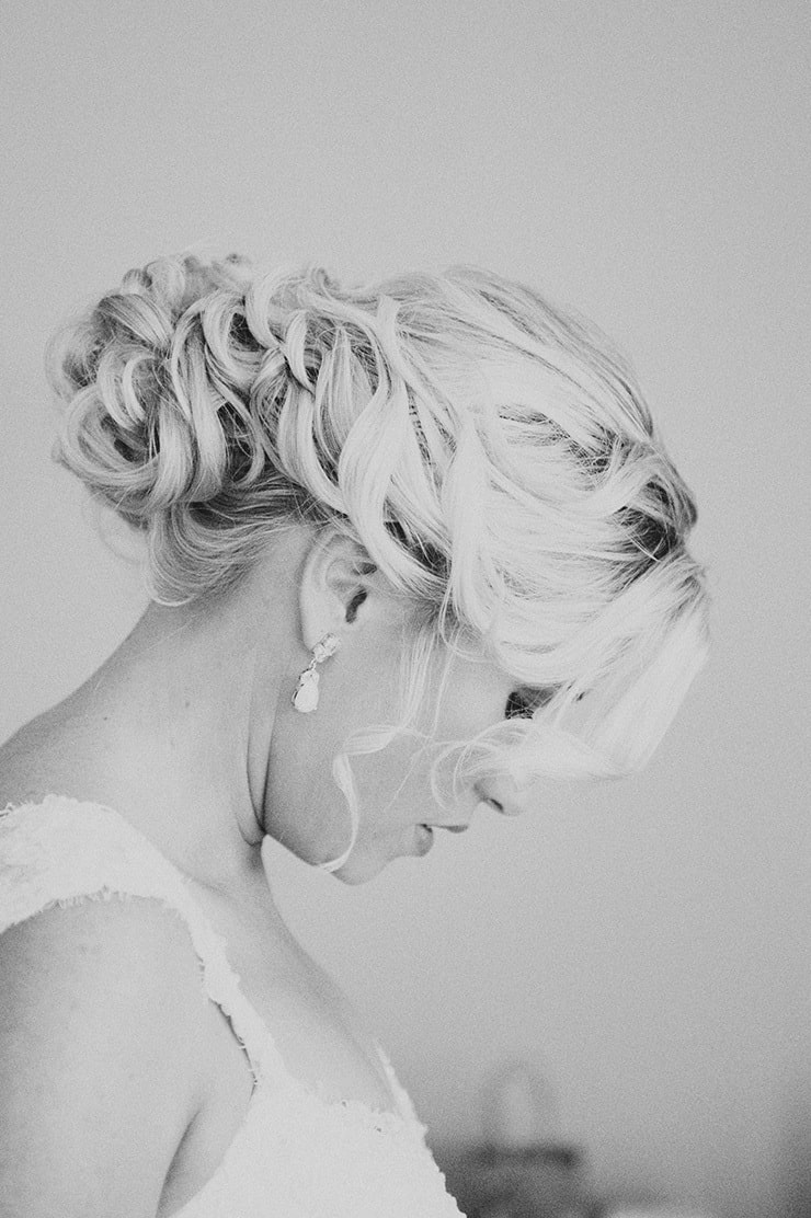 Elegant curled updo for rustic winery wedding