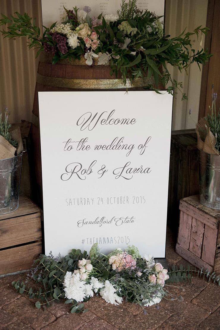 Rustic winery wedding welcome sign