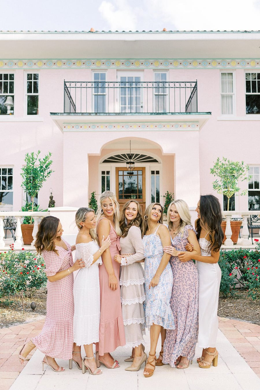 Spring pastel mismatched bridesmaid dresses in pretty prints paired with nude heels | Photography: Sandra Morlet Photography via Ruffled