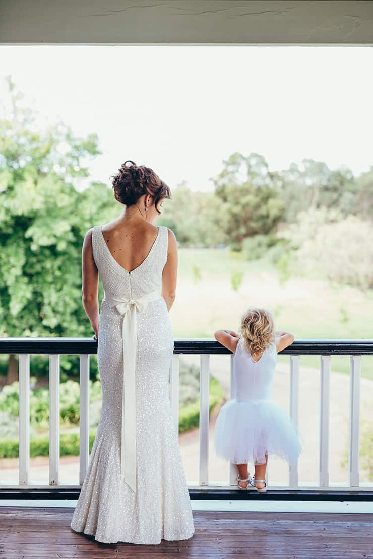 Sweet moment between bride and flower girl
