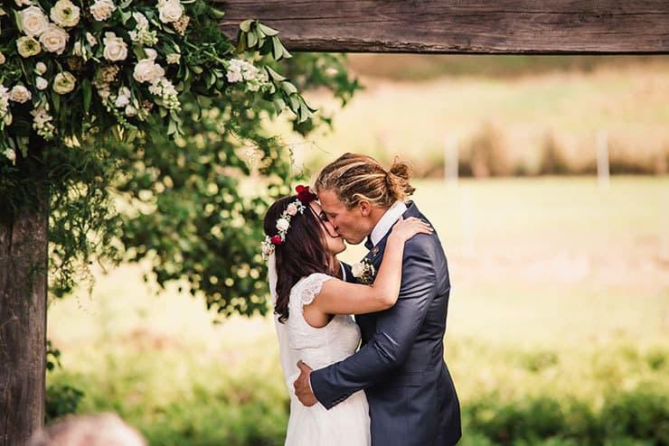 Vibrant-Heartfelt-Bohemian-Wedding-Ceremony-Bride-Groom-Kiss