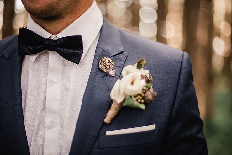 Vibrant-Heartfelt-Bohemian-Wedding-Groom-Navy-Suit-Boutonniere-Pin