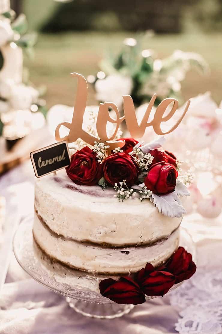 Vibrant-Heartfelt-Bohemian-Wedding-Reception-Dessert-Table-Cake-Red-Roses-Love-Topper