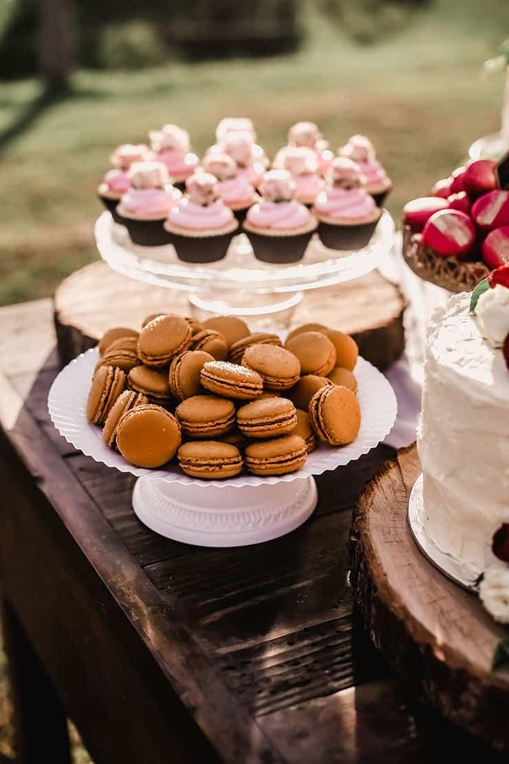 Vibrant Heartfelt Bohemian Wedding Reception Dessert Table Macarons The Wedding Playbook