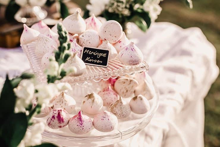 Vibrant-Heartfelt-Bohemian-Wedding-Reception-Dessert-Table-Meringue-Kisses