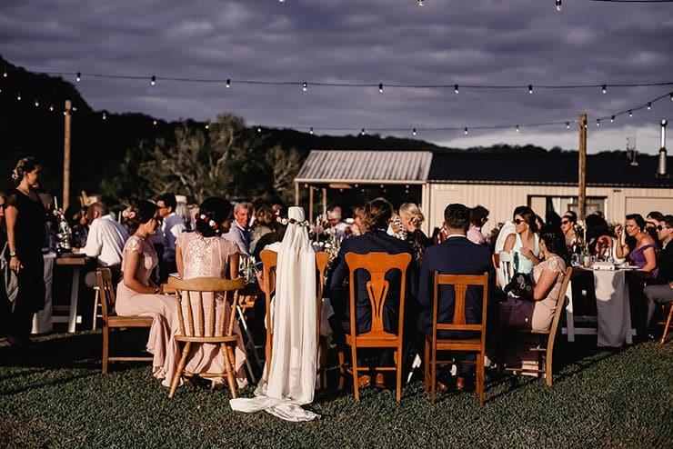 Vibrant-Heartfelt-Bohemian-Wedding-Reception-Table-Setting-Guests